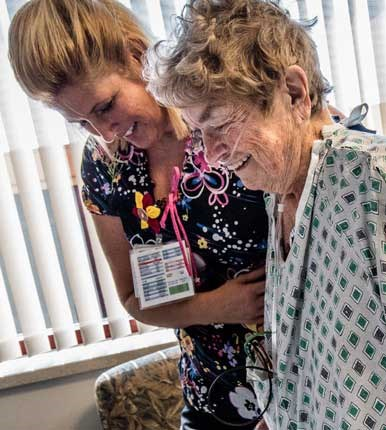 Nurse happily interacting with a patient