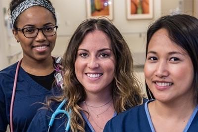 Group of nurses in blue scrubs