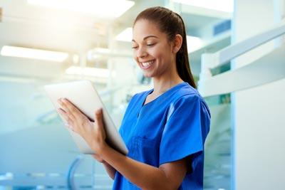 Nurse holding a tablet.