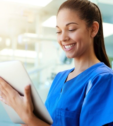 Nurse holding a tablet and typing