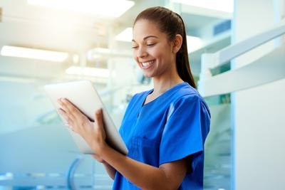 Nurse holding a tablet.